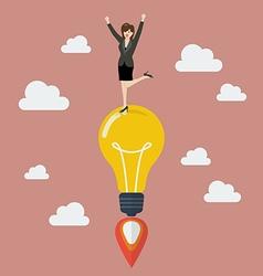 Business woman celebrating on a lightbulb idea vector image vector image