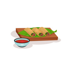 Spring rolls with meat and vegetables on wooden vector