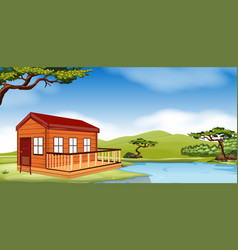 wooden cottage by the river vector image