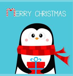Merry christmas penguin holding gift box present vector