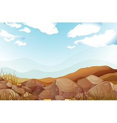 Big brown rocks under the blue sky vector image