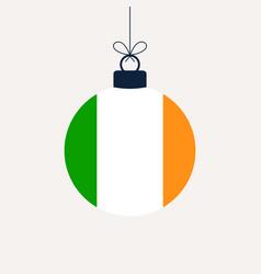 christmas ball with ireland flag greeting card vector image