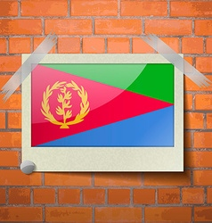 Flags Eritrea scotch taped to a red brick wall vector image