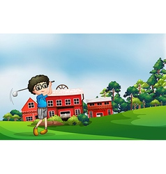 A boy playing golf near barn vector