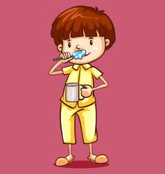 Boy in pajamas brushing teeth vector