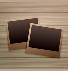 Old photo frames on wooden background vector