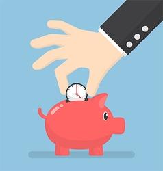 Businessman hand putting clock into piggy bank vector image