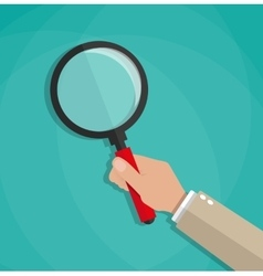 hand holding a magnifying glass vector image