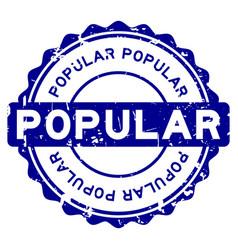 grunge blue popular word round rubber seal stamp vector image