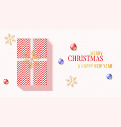 greetings card with gift box gold snowflakes vector image