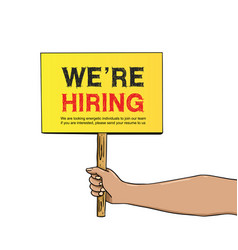 Hand holding yellow board with we are hiring sign vector