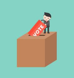 tiny man dropping ballot into big box vote and vector image