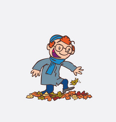 Red hair child having fun treading autumn leaves vector