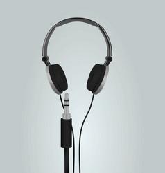 Audio jack and grey earphones vector
