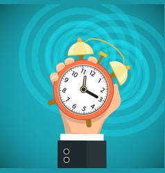 Human hand holding a alarm clock flat graphic vector