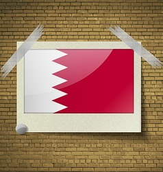 Flags Bahrain at frame on a brick background vector image