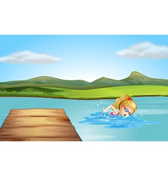 A girl swimming at the beach with a diving board vector image vector image