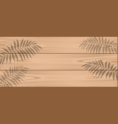 Shadow of palm branches on light wooden boards vector