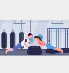 sports couple doing push-up exercise on tires man vector image