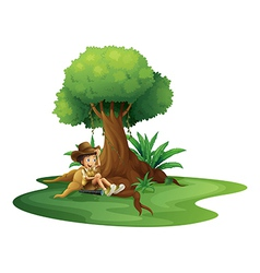 A boy resting under the tree vector