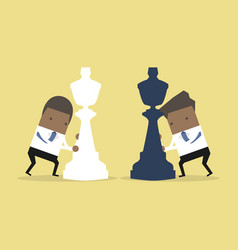 African businessman moving chess pieces vector