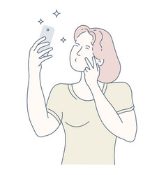 Young woman taking a selfie on her smartphone vector