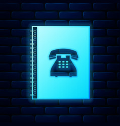 Glowing neon phone book icon isolated on brick vector