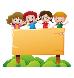 Four children standing behind wooden sign vector