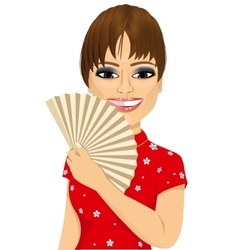 Chinese model in Cheongsam dress holding a fan vector image