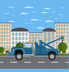 Tow truck on road in urban landscape vector