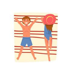 couple sunbathing on beach towel top view vector image