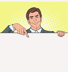 Pop art businessman pointing on blank billboard vector