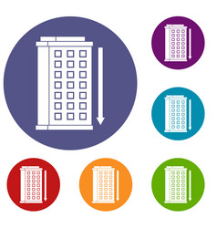 Tall building and down arrow icons set vector