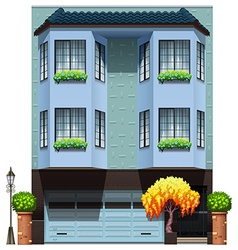 A building with decorative plants vector