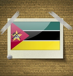 Flags Mozambique at frame on a brick background vector image vector image