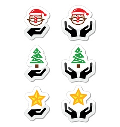 Hands with christmas icons - santa claus tree vector image
