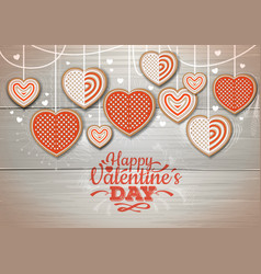 Top view of valentine cookies on wooden background vector