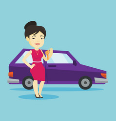woman holding keys to her new car vector image