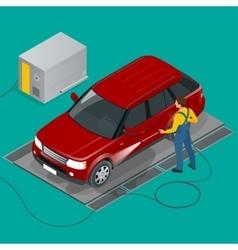 Car wash specialist in uniform washing sedan car vector image
