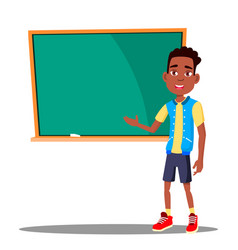 Little boy answers at the blackboard in the vector