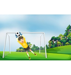A boy in a yellow uniform catching the ball vector image