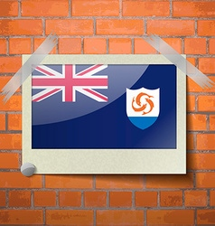 Flags Anguilla scotch taped to a red brick wall vector