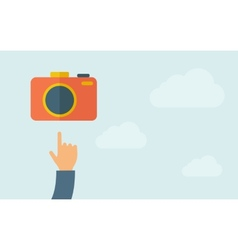 Hand pointing to a camera icon vector