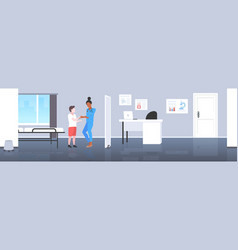 doctor pediatrician reassuring boy patient woman vector image