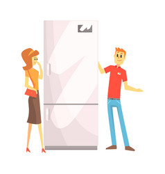 woman choosing fridge with shop assistant help vector image vector image