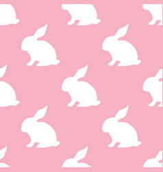 Seamless pattern with silhouette of bunny on pink vector