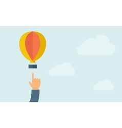 Hand pointing hot air balloon vector