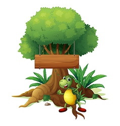 A turtle under the big tree with a wooden vector image