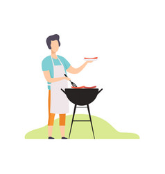 young man cooking sausages on barbecue grill vector image