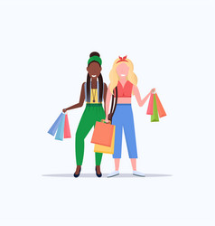 mix race women holding colorful paper bags couple vector image